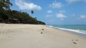 Peaceful beach in Thailand,blue sky, blue water , white sand and green mountain Stock Photo