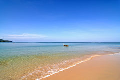 Free Peaceful Beach With Boat Stock Image - 9356691