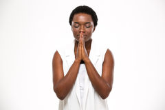 Peaceful beautiful african american young woman standing and praying royalty free stock image