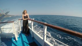 Peaceful beautiful woman in summer vacation sailing in cruise boat watching the sea  -. Peaceful beautiful woman in summer vacation sailing in cruise boat stock video