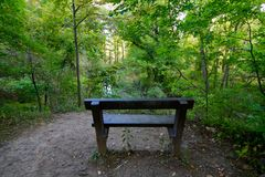 Peaceful Bench in Cuyahoga Valley National Park in the Fall Morning Sun - BRECKSVILLE - OHIO. Cuyahoga Valley National Park lies along the Cuyahoga River between royalty free stock photo