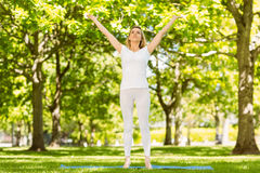 Peaceful blonde doing yoga in the park Royalty Free Stock Photos