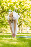 Peaceful blonde doing yoga in the park Stock Image