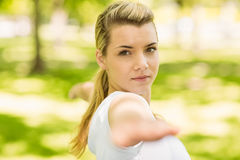 Peaceful blonde doing yoga in the park Royalty Free Stock Image