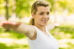 Peaceful blonde doing yoga in the park Stock Photography