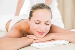 Peaceful blonde enjoying an exfoliating back massage Stock Photo