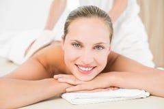 Peaceful blonde enjoying an exfoliating back massage Stock Images