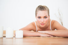 Peaceful blonde lying on bamboo mat Royalty Free Stock Photos