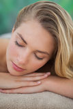 Peaceful blonde lying on towel Stock Photography