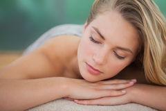 Peaceful blonde lying on towel Royalty Free Stock Photo