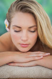 Peaceful blonde lying on towel Royalty Free Stock Photos
