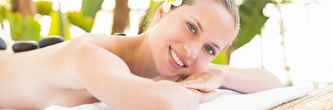 Peaceful blonde lying on towel. At the health spa Stock Photos