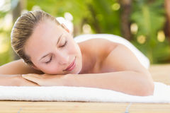 Peaceful blonde lying on towel Royalty Free Stock Photography
