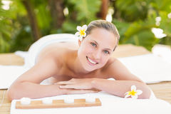 Peaceful blonde lying on towel Stock Image