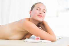 Peaceful blonde lying on towel Royalty Free Stock Images