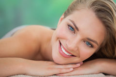 Peaceful blonde lying on towel smiling at camera Royalty Free Stock Image