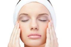 Peaceful blonde model wearing headband closing eyes Royalty Free Stock Photo