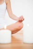 Peaceful blonde sitting in lotus pose Stock Image