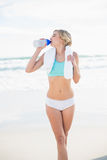 Peaceful blonde woman in sportswear drinking water Stock Images