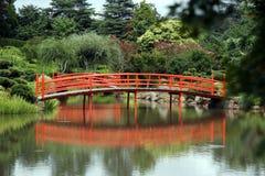 Peaceful bridge scene. Peaceful scenic view of a Japanese style bridge Royalty Free Stock Photo