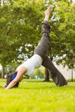 Peaceful brown hair doing yoga on grass Royalty Free Stock Images
