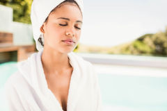 Peaceful brunette with closed eyes wearing white towel Royalty Free Stock Photography