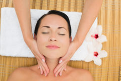 Peaceful brunette enjoying a facial massage Stock Image