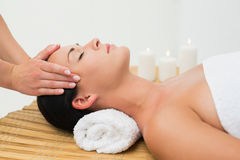 Peaceful brunette enjoying a facial massage Stock Images