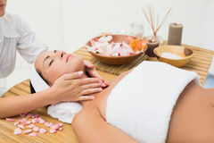 Peaceful brunette enjoying a neck massage Stock Photos