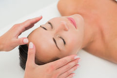 Peaceful brunette getting reiki therapy Royalty Free Stock Images
