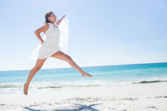 Peaceful brunette jumping Stock Photography