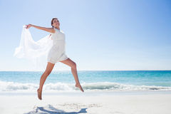 Peaceful brunette jumping Royalty Free Stock Photos