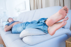 Peaceful brunette listening music on couch Royalty Free Stock Image