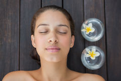 Peaceful brunette lying with eyes closed Royalty Free Stock Photography