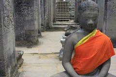 Peaceful Buddha. Buddha statue with orange robe taken at Angkor Watt in Cambodia Stock Image