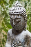 Peaceful buddhist statue. The stone buddhist statue in an old chinese temple Royalty Free Stock Photography