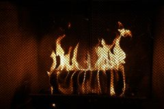 Toasty Fire Log In Fireplace stock photography