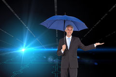Peaceful businessman holding blue umbrella Royalty Free Stock Photography
