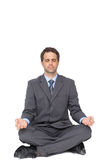 Peaceful businessman meditating in lotus pose Royalty Free Stock Photos