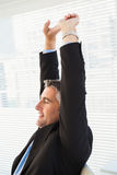 Peaceful businessman stretching his arms Stock Photography