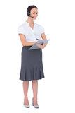Peaceful call center agent holding clipboard Royalty Free Stock Photos