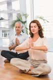 Peaceful casual business colleagues meditating Stock Images