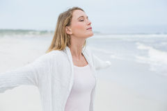 Peaceful casual woman with eyes closed at beach Stock Images