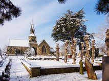 Peaceful Cemetery in Winter Snow. Peaceful snowy winter scene at the cemetery in Melbourne, Derbyshire, England Royalty Free Stock Photo