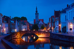 Peaceful cityscape at night from canal in Bruges. Peaceful cityscape at night from the canal in Bruges, Belgium Royalty Free Stock Images