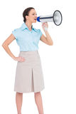 Peaceful classy businesswoman talking in megaphone Royalty Free Stock Images