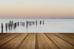 Peaceful concept landscape image of smooth sea and pier ruins wi Stock Photo