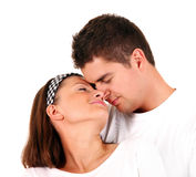 Peaceful couple. A picture of a young peaceful couple hugging against white background Royalty Free Stock Images