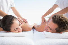 Peaceful couple enjoying couples massage poolside Royalty Free Stock Photos