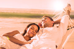 Peaceful couple napping in a hammock Stock Images
